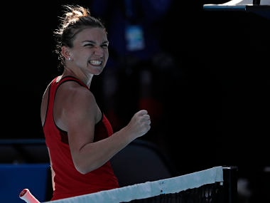 Romania's Simona Halep celebrates after defeating Karolina Pliskova of the Czech Republic in their quarterfinal at the Australian Open tennis championships in Melbourne, Australia, Wednesday, Jan. 24, 2018. (AP Photo/Vincent Thian)