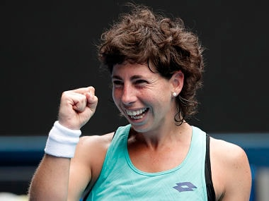 Spain's Carla Suarez Navarro celebrates after defeating Anett Kontaveit of Estonia in their fourth round match at the Australian Open tennis championships in Melbourne, Australia Sunday, Jan. 21, 2018. (AP Photo/Vincent Thian)