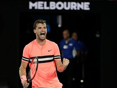 Bulgaria's Grigor Dimitrov celebrates after defeating Australia's Nick Kyrgios during his fourth round match at the Australian Open tennis championships in Melbourne, Australia Sunday, Jan. 21, 2018. (AP Photo/Dita Alangkara)