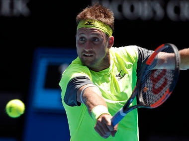United States' Tennys Sandgren hits a backhand return to South Korea's Chung Hyeon during their quarterfinal at the Australian Open tennis championships in Melbourne, Australia, Wednesday, Jan. 24, 2018. (AP Photo/Vincent Thian)