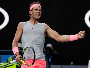 Spain's Rafael Nadal celebrates a point win against Argentina's Diego Schwartzman during their fourth round match at the Australian Open tennis championships in Melbourne, Australia Sunday, Jan. 21, 2018. (AP Photo/Dita Alangkara)