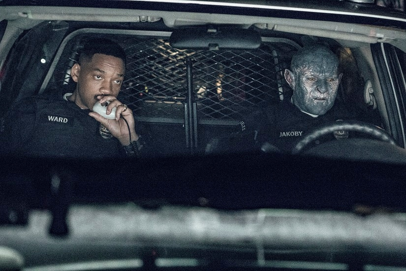 "FILE - This undated image released by Netflix shows Will Smith, left, and Joel Edgerton in a scene from, ""Bright."" Despite scathing reviews from critics, Netflix has greenlit a sequel to ""Bright,"" with star Smith and director David Ayer expected to return. The streaming service announced the plans Wednesday, Jan. 3, 2018, just two weeks after the fantasy police drama debuted. (Matt Kennedy/Netflix via AP, File)"