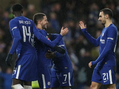 Chelsea's Eden Hazard celebrates with teammates after beating Norwich 5-3 on penalties. Reuters
