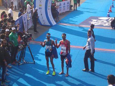 Gopi Thonakal (left) and Nitendra Singh Rawat pose after finishing the race. Image courtesy:Twitter @TataMumMarathon