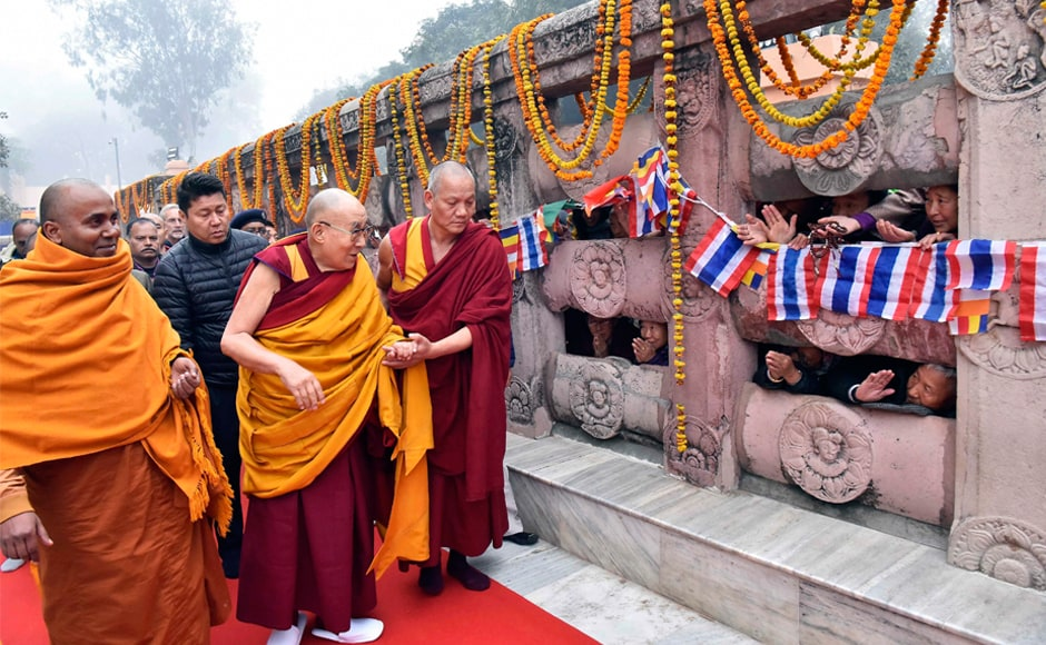 Tibetan spiritual leader the Dalai Lama greets other priests at the Mahabodhi Temple in Bodh Gaya on Saturday. He has been camping there since 2 January and is likely to stay till 1 February. PTI