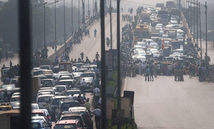 Dalit protesters block the traffic at Western Express Highway near Aarey Check Naka during a 'Rasta Roko' protest over Bhima Koregaon violence, in Mumbai on Wednesday. PTI