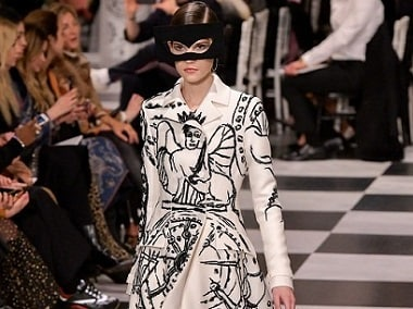 Dior designer Maria Grazia Chiuri channels surrealism in predominantly black-and-white fashion show