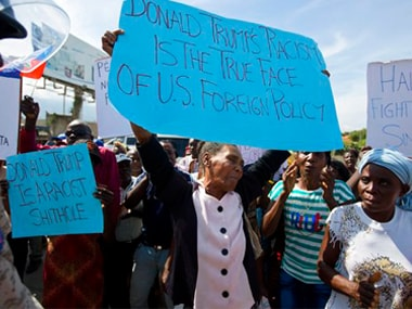Demonstrators protest in front of the U.S. embassy against President Donald Trump's recent disparaging comments about Haiti and African nations in Port-au-Prince. AP