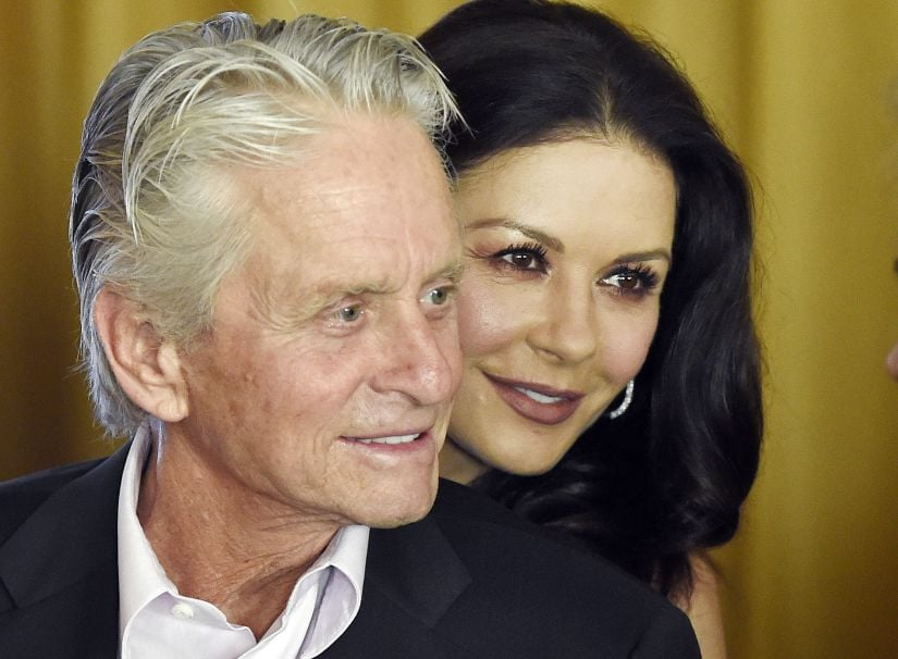 FILE - In this Dec. 9. 2016, file photo, actor Michael Douglas and his wife, actress Catherine Zeta-Jones, attend a party at the Beverly Hills Hotel in Beverly Hills, Calif. Catherine Zeta-Jones said that her husband, who has denied allegations of sexual harassment, is a strong supporter of the #MeToo movement. (Photo by Chris Pizzello/Invision/AP, File)