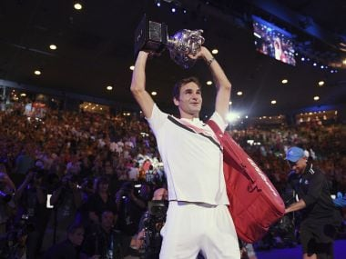 Roger Federer holds his trophy up after defeating Croatia's Marin Cilic in the men's singles final at the Australian Open tennis championships in Melbourne, Australia, on 28 January. AP
