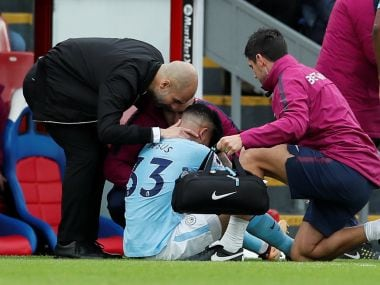 Manchester City manager Pep Guardiola with Manchester City's Gabriel Jesus as he receives medical attention. Reuters