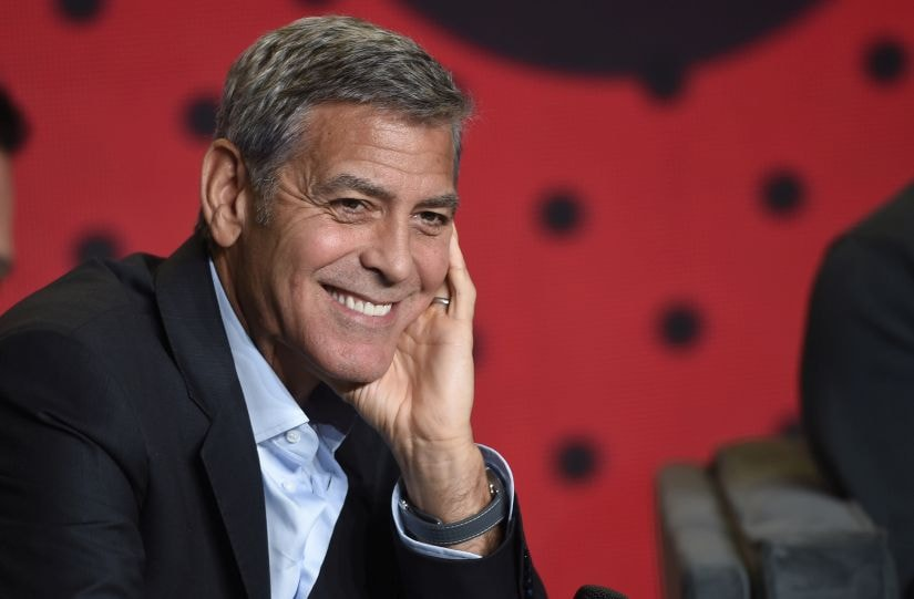 """FILE- In this Sept. 10, 2017, file photo, George Clooney attends a press conference for """"Suburbicon"""" on Day 4 of the Toronto International Film Festival in Toronto. Clooney is directing and starring in a TV series version of the novel """"Catch-22."""" The streaming service Hulu said Sunday, Jan. 14, 2018, that the six-part series based on Joseph Heller's anti-war satire will go into production in 2018. (Photo by Chris Pizzello/Invision/AP, File)"""