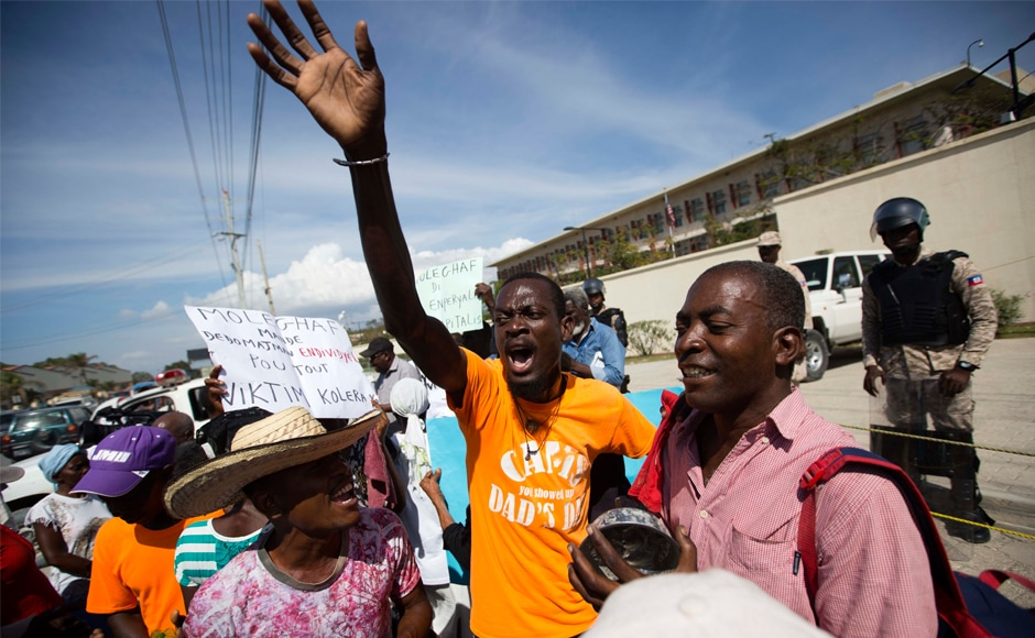 Dozens protest against Donald Trump's 'shithole' remark outside US embassy in Haiti