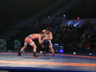 Haryana Hammers Vladimir Khinchegashvili(orange) beat Mumbai Maharathis Eedenebatyn Bekhbayar(white) by 8-4 on day 12 of the 3rd Pro Wrestling League being held at Siri Fort Stadium in New Delhi. PWL