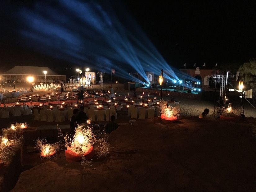 The stage lights illuminate the dunes