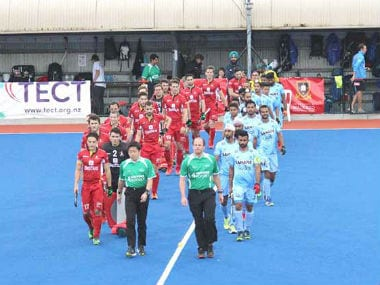 The Indian and Belgian teams walk out at the start of their match. Image credit: Twitter/@TheHockeyIndia