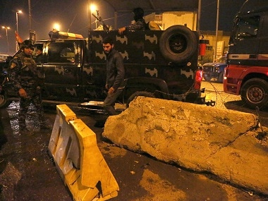 Iraqi security forces gather at the scene of a suicide bombing in Baghdad. AP