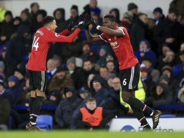 Manchester United's Jesse Lingard, left celebrates scoring his side's second goal of the game, during the English Premier League match against Everton. AP