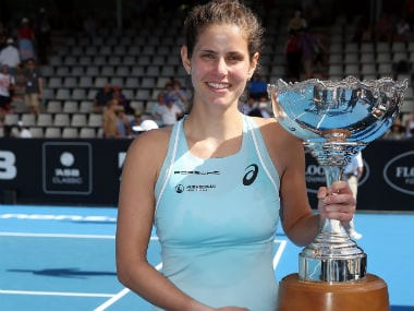 Julia Goerges poses with the trophy after beating Caroline Wozniacki. AFP