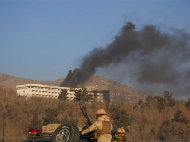Black smoke rises from the Intercontinental Hotel after an attack in Kabul on Sunday. AP