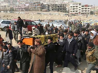 Men carry the coffin of a relative who died in Saturday's deadly suicide attack in Kabul, Afghanistan. AP