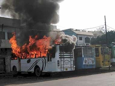 A bus set on fire by a group of people who went on a rampage after the cremation of a young man killed on Friday during the Tiranga bike rally, in Kasganj on Saturday. PTI