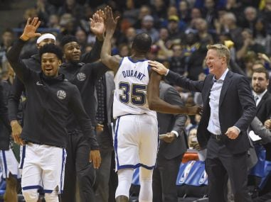 Golden State Warriors head coach Steve Kerr greets Kevin Durant (35) during the game against the Milwaukee Bucks. Reuters