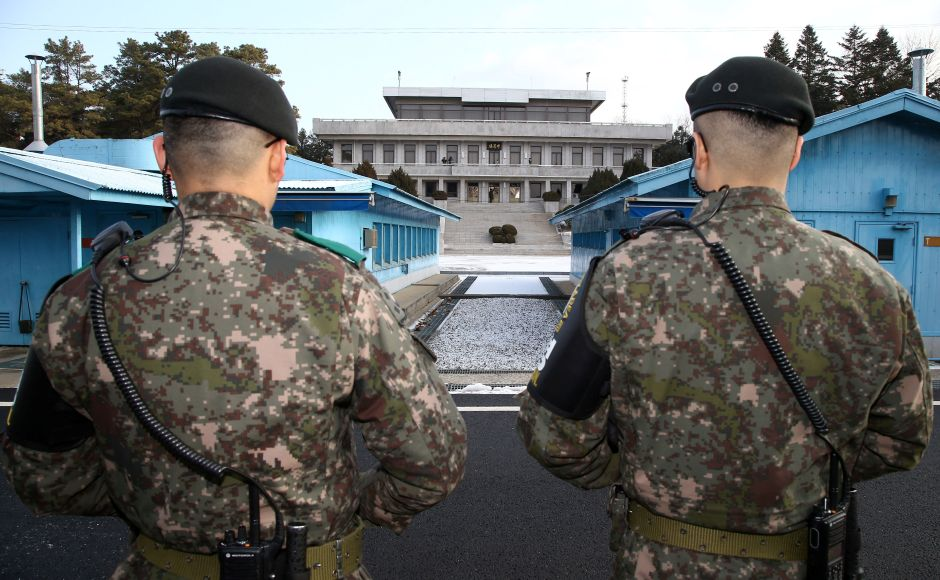 South Korean soldiers stand guard at the truce village of Panmunjom in the demilitarised zone separating the two Koreas, South Korea. Reuters
