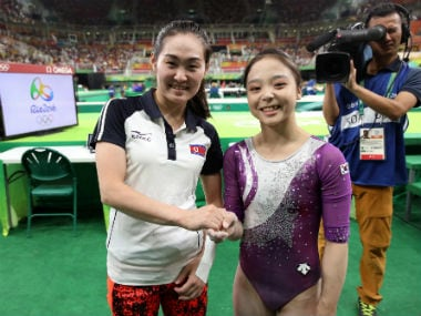 File photo of South Korean gymnast Lee Eun-ju, right, and her North Korean counterpart Hong Un Jong shake hands and smile together for photographers during the artistic gymnastics women's qualification at the 2016 Summer Olympics in Rio de Janeiro, Brazi.