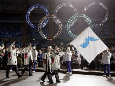 Korea flag-bearer's Bora Lee and Jong-In Lee, carrying a unification flag lead their teams into the stadium during the 2006 Winter Olympics opening ceremony in Turin, Italy. AP