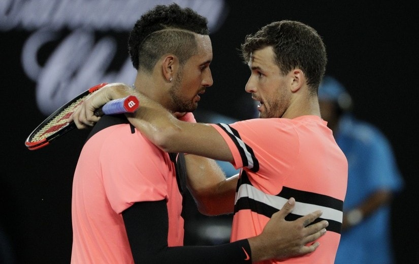 Grigor Dimitrov, right, is congratulated by Nick Kyrgios after winning their fourth round match at the Australian Open. AP