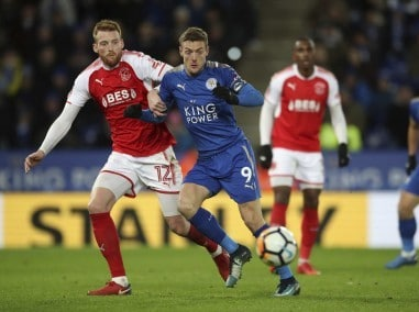 Leicester City's Jamie Vardy and Fleetwood Town's Cian Bolger, left, battle for the ball during the FA Cup replay. AP