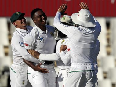Lungi Ngidi celebrates with teammates after dismissing Virat Kohli in the final session on Day 4 at Centurion. AP