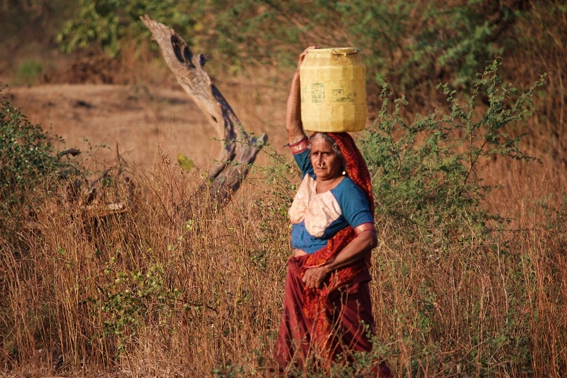 Maldhari woman gathering water