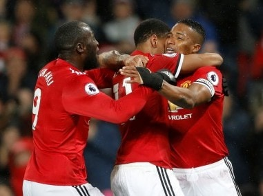 Manchester United's Antonio Valencia celebrates scoring their first goal with Anthony Martial and Romelu Lukaku. Reuters
