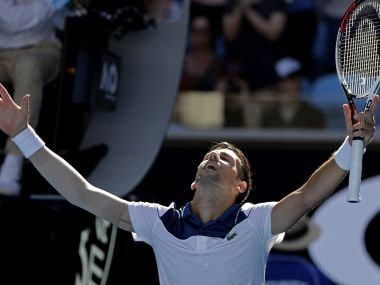 Novak Djokovic reacts after beating Donald Young on Tuesday. AP