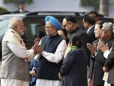 File image of Narendra Modi and Manmohan Singh. PTI