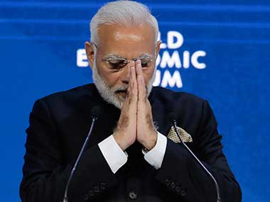 Prime Minister Narendra Modi greets the audience after delivering his speech at the World Economic Forum in Davos. AP