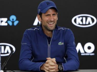 Novak Djokovic smiles during a press conference at the Australian Open. AP