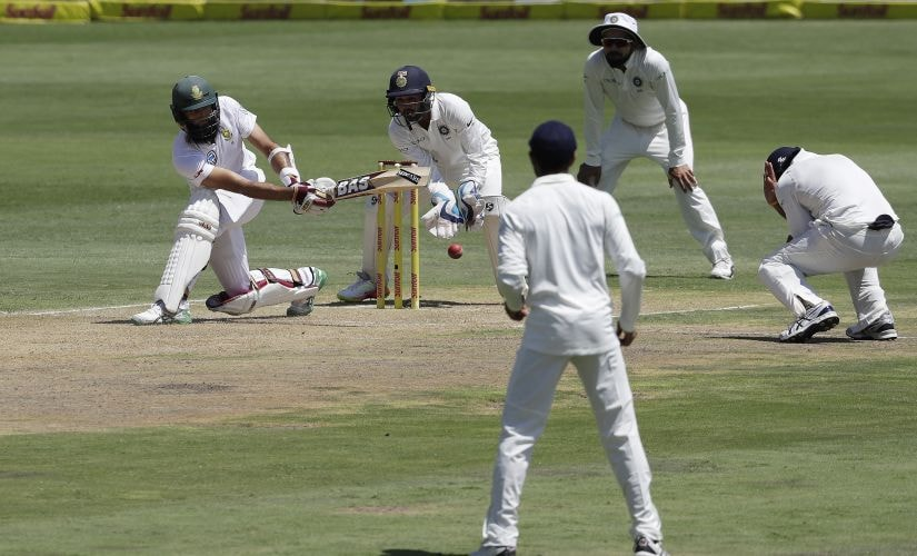 South Africa's batsman Hashim Amla' far left, plays a side shot as India's wicketkeeper Parthiv Patel, second from left, and teammates watches during the first day of the second cricket test match between South Africa and India at Centurion Park in Pretoria, South Africa, Saturday, Jan. 13, 2018. (AP Photo/Themba Hadebe)