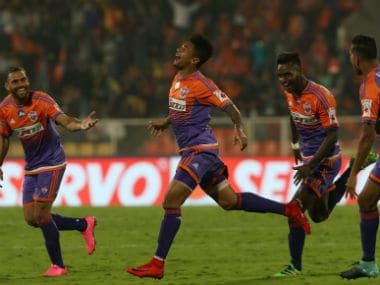 FC Pune City players celebrate a goal against ATK in their Indian Super League match. ISL