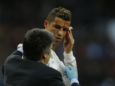 Real Madrid's Cristiano Ronaldo bleeds from his forehead during the match against Deportivo Coruna. AP