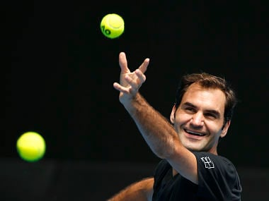 Tennis - Australian Open - Melbourne, Australia, January 14, 2018. Roger Federer of Switzerland laughs as he serves during a practice session before the Australian Open tennis tournament. REUTERS/Toru Hanai - HP1EE1E0478SW