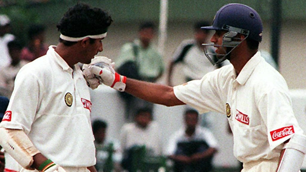 Indian batsman Rahul Dravid (R) congratulates team mate Sadagopan Ramesh as he got his century 24 February on the first day of the first test in the Asian championships. Ramesh was out for 143. AFP PHOTO