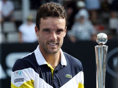 Roberto Bautista Agut holds the trophy as he celebrates winning against Juan Martin Del Potro. AFP
