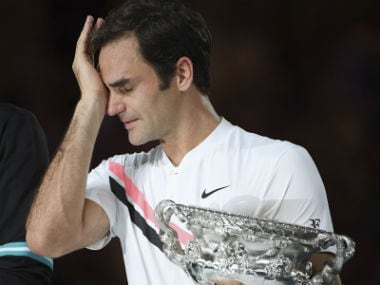 Roger Federer couldn't hold back his tears after winning the Australian Open Men's Singles final against Marin Cilic. AP