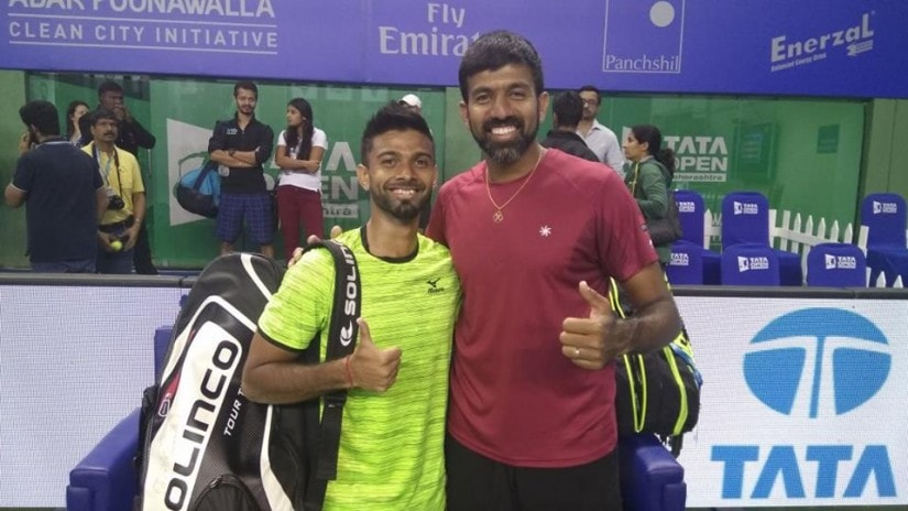 Defending champions Rohan Bopanna and Jeevan Nedunchezhiyan after their win in the first round. Tata Maharashtra Open