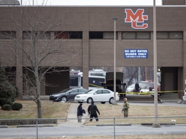 Authorities investigate the scene after a deadly shooting at Marshall County High School in Benton, Ky., Tuesday, Jan. 23, 2018. (Ryan Hermens/The Paducah Sun via AP)