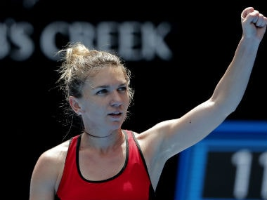 Simona Halep celebrates after her hard-fought win over .AP