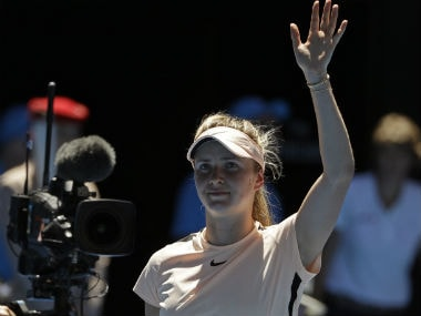 Ukraine's Elina Svitolina waves after defeating compatriot Marta Kostyuk in their third round match at the Australian Open. AP
